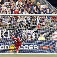 Chicago Fire defender Bakary Soumare (4) clears the ball after it crossed the goal line. In a Major League Soccer (MLS) match, the New England Revolution (blue) defeated Chicago Fire (red), 2-0, at Gillette Stadium on August 17, 2013.
