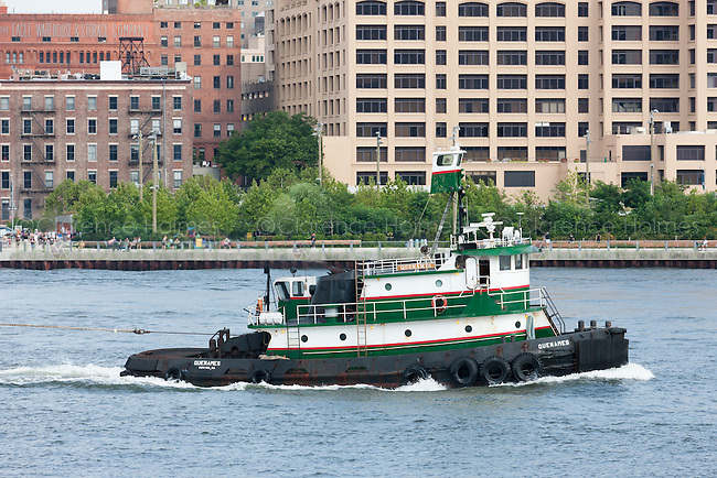 Tugboat Quenames towing a barge on the East River past Brooklyn Bridge Park