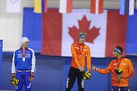 SPEEDSKATING: CALGARY: 14-11-2015, Olympic Oval, ISU World Cup, Podium Men 1000m, Pavel Kulizhnikov (RUS), Gerben Jorritsma (NED), Kjeld Nuis (NED), ©foto Martin de Jong