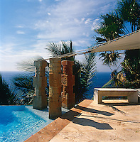 The granite columns beside the pool are 8th century Indian