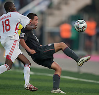 Luis Gil kicks the ball ahead of Kelvin Hanganda. US Men's National Team Under 17 defeated Malawi 1-0 in the second game of the FIFA 2009 Under-17 World Cup at Sani Abacha Stadium in Kano, Nigeria on October 29, 2009.