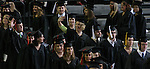 A graduate gives a wave of recognition to friends and family members at commencement day at Drake University in 2005..The private University in Des Moines, Ia., has been lauded for it's outstanding programs in the arts in addition to having one of the best law schools and pharmacy departments in the country.