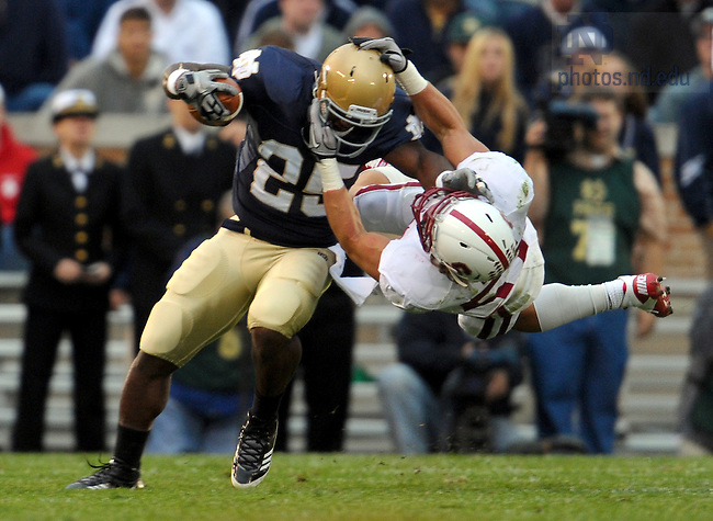 Jonas Gray (25) is tackled by Stanford Cardinal linebacker Max Bergen (57) in the third quarter.  The officials ruled no facemask on the play...