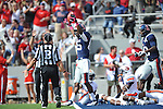 Ole Miss wide receiver Ja-Mes Logan (85) makes a 40 yard reception between Auburn defensive back Jonathan Jones (21) and Auburn defensive back Demetruce McNeal (12) at Vaught-Hemingway Stadium in Oxford, Miss. on Saturday, October 13, 2012.