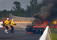 Mar 18, 2016; Gainesville, FL, USA; NHRA safety safari rescue crews work to extinguish the fire to the pro mod driver Dan Stevenson after an explosion during qualifying for the Gatornationals at Auto Plus Raceway at Gainesville. Mandatory Credit: Mark J. Rebilas-USA TODAY Sports