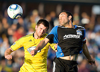 Jason Garey of the Crew battles for the ball in the air against Ramiro Corrales of the Earthquakes during the first half of the game at Buck Shaw Stadium in Santa Clara, California.  San Jose Earthquakes tied Columbus Crew, 2-2.