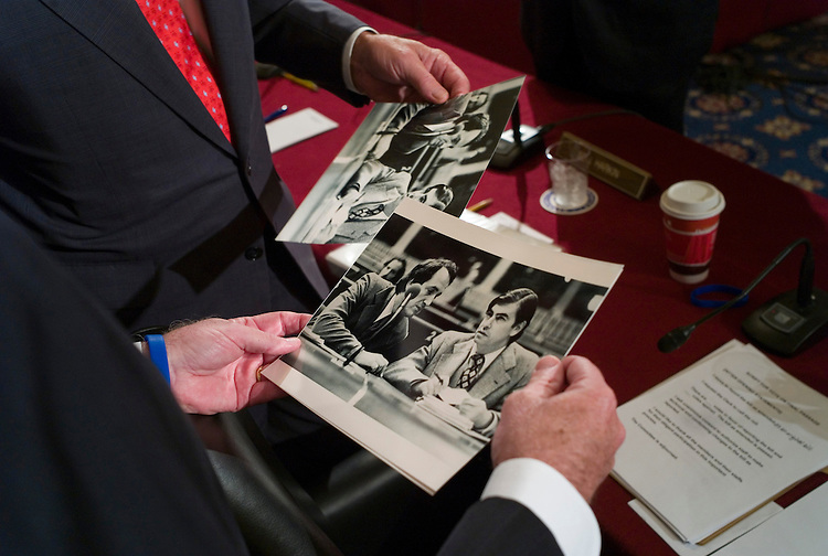 WASHINGTON, DC - July 15: Sen. Tom Harkin, D-Iowa, and Sen. Christopher J. Dodd, D-Conn., sitting in for the ailing Chairman Edward M. Kennedy, D-Mass., hold photos of themselves from the mid-1970s after the final day of the Senate Health, Education, Labor and Pensions markup of a comprehensive healthcare overhaul bill. The package was approved by the panel by a partisan 13-10 vote. Committee aides asked the two to autograph the photos after the markup. The markup lasted 13 days and 60 hours. (Photo by Scott J. Ferrell/Congressional Quarterly)