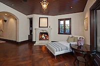 Stock photo of daybed by fireplace