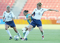 17 August 2004:   Cindy Parlow and Aly Wagner fight for the ball against Australia at Kaftanzoglio Stadium in Thessaloniki, Greece.     USA tied Australia at 1-1.   Credit: Michael Pimentel / ISI