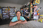 A woman sells basic items from a small store in her home in Victoria 20 de enero, a village of former Guatemalan refugees in Mexico who returned home as a group in 1993, while the country's bloody civil war still raged.