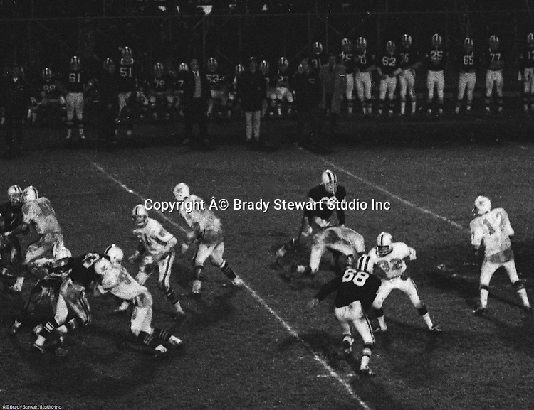 Bethel Park PA:  Offensive play with Mike Stewart scoring on an end run after great blocks from Dennis Franks 66 and Dan Hannigan 64.  Others in the photo; Gary Biro 81, Clark Miller 40, Chip Huggins 32, Don Troup 51, Bob Hensler 77,   The Bethel Park offense and defense played very well in the 16-0 shut out of the Upper St Clair Panthers. The defensive unit was one of the best in Bethel Park history only allowing a little over 7 points a game.