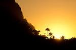 Sunset behind ridge seen from Ha'ena Beach, Kauai, Hawaii