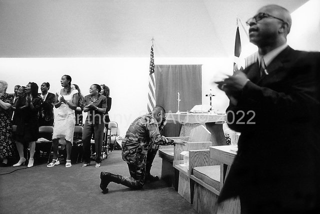 Fort Stewart, Georgia.USA.March 30, 2003..A gospel service is held at the chapel on Fort Stewart militray base, Georgia. Much of the service revolves around the war in Iraq. A special prayer is said for the spouses of service men serving in the gulf.
