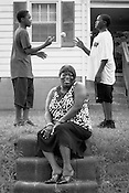 Cynthia Edwards and her children, Nathan, right, and Dontae, outside their former home in  East Durham, August 1, 2008. ..Photo By Jeyhoun Allebaugh