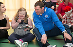 St Johnstone players visit Fairview School in Perth.....19.12.13<br /> Tommy Wright playing pass the parcel with Jessica Drummond<br /> Picture by Graeme Hart.<br /> Copyright Perthshire Picture Agency<br /> Tel: 01738 623350  Mobile: 07990 594431