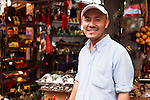 Shop owner at an antique market in the Old Town of Shanghai, China