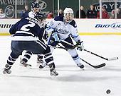 Connor Hardowa (UNH - 2) (Kipp), Joey Diamond (Maine - 39) - The University of Maine Black Bears defeated the University of New Hampshire Wildcats 5-4 in overtime on Saturday, January 7, 2012, at Fenway Park in Boston, Massachusetts.