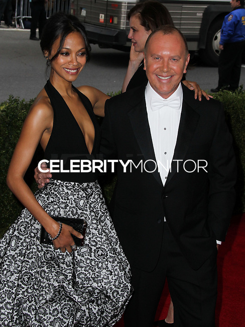 """NEW YORK CITY, NY, USA - MAY 05: Zoe Saldana, Michael Kors at the """"Charles James: Beyond Fashion"""" Costume Institute Gala held at the Metropolitan Museum of Art on May 5, 2014 in New York City, New York, United States. (Photo by Xavier Collin/Celebrity Monitor)"""