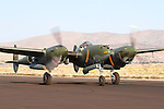 Steve Hinton taxies a Lockheed P-38 Lightning known as Glacier Girl along the ramp at Stead Field in Nevada. In July of 1942 the aircraft was forced to make an emergency landing in Greenland while en-route to the British Isles. Five other p-38's and 2 B-17 bombers where eventually buried beneath 270 feet of ice. In 1992 Glacier Girl was brought to the surface and transported to Middlesboro, Kentucky, for restoration to flying condition. On October 26, 2002 Steve Hinton took Glacier Girl into the air for the first time in over 60 years. Photographed 09/07