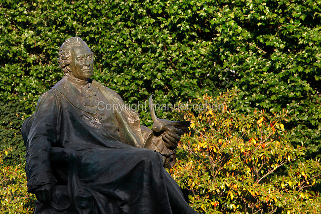 Mid-length view from the side of the statue of Georges-Louis Leclerc, comte de Buffon, created by Jean Carlus (1852-1930) in 1902, located in the Jardin des Plantes, Paris, 5th arrondissement, France. Founded in 1626 by Guy de La Brosse, Louis XIII's physician, the Jardin des Plantes, originally known as the Jardin du Roi, opened to the public in 1640. It became the Museum National d'Histoire Naturelle in 1793 during the French Revolution. Picture by Manuel Cohen
