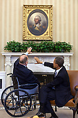 United States President Barack Obama meets with former U.S. Senator Max Cleland (Democrat of Georgia) and current Secretary of the American Battle Monuments Commission, in the Oval Office, February 21, 2012. .Mandatory Credit: Pete Souza - White House via CNP