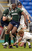 Reading, ENGLAND, Topsy Ojo, jumps clear of, Hugh Vyvyans lunging tackle during the London Irish vs Saracens, Guinness Premiership Rugby, at the, Madejski Stadium, 06.05.2006, © Peter Spurrier/Intersport-images.com,  / Mobile +44 [0] 7973 819 551 / email images@intersport-images.com.