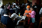 ADDIS ABABA, ETHIOPIA - NOVEMBER 14: A middle class family have coffee and cake at Kaldis, a (Starbucks copy) on November 14, 2010 in Addis Ababa, Ethiopia. There's a big cafe culture in Addis and the many restaurants as many local people live outside the city center and they eat lunch every day. Some people can afford to buy expensive locally and imported cloths despite that this one of Africa's poorest countries. (Photo by Per-Anders Pettersson)