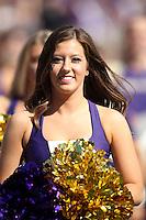 2013-09-21: Washington cheerleader Mallory Cracker entertained fans during the game  against Idaho State.  Washington won 56-0 over Idaho State in Seattle, WA.