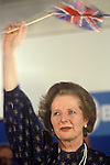 Mrs Margaret Thatcher 1983 election waving Union Jack flag with tears in her eyes.