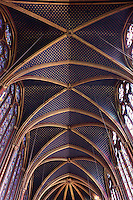 View from below of the ceiling of the nave in the upper chapel of La Sainte-Chapelle (The Holy Chapel), 1248, Paris, France. The ribs are underlined with red strips with golden L. and the vaults are covered by golden stars. La Sainte-Chapelle was commissioned by King Louis IX of France to house his collection of Passion Relics, including the Crown of Thorns. The Sainte-Chapelle is considered among the highest achievements of the Rayonnant period of Gothic architecture. Picture by Manuel Cohen