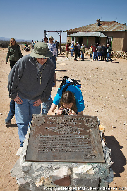Visitors to the Trinity Atomic Bomb Test Site near Socorro, NM, examine a placard at the Mc Donald cabin, part of the historic complex where the famous tests were conducted in 1944.