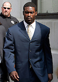 Atlanta Falcons quarterback Michael Vick leaves federal court  after pleading guilty in a dogfighting case in Richmond, Va., Monday, Aug. 27, 2007.  (AP Photo/Steve Helber/POOL)