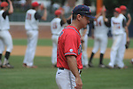 Mississippi Head Coach Mike Bianco (5) walks towards the outfield as St. John's players congratulate each other following an NCAA Regional game at Davenport Field in Charlottesville, Va. on Sunday, June 6, 2010. St. John's won 20-16.