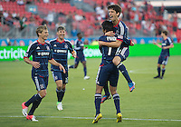 12 September 2012: Chicago Fire midfielder Alvaro Fernandez #4 celebrates his goal during the first half in an MLS game between the Chicago Fire and Toronto FC at BMO Field in Toronto, Ontario Canada.
