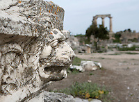 CORINTH, GREECE - APRIL 16 : A detail of Roman sculpture, on April 16, 2007 in Corinth, Greece. This sculpted profile of a lion's head is seen in the early morning light with the Temple of Apollo in the background. Corinth, founded in Neolithic times, was a major Ancient Greek city, until it was razed by the Romans in 146 BC. Rebuilt a century later it was destroyed by an earthquake in Byzantine times. (Photo by Manuel Cohen)