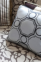Detail of patterned scatter cushions on a patterned sofa