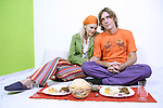 Couple having meal on the floor of photo studio