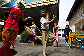 """A dancer performs the """"peacock dance"""" in Ruili town, Yunnan province, southwestern China."""
