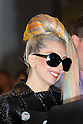 """Lady Gaga arrives at Narita Airport, Tokyo, on Tuesday, May 8, 2012. She had her hair rainbow colored and was wearing high heels and sunglasses and a black studded leather jacket..The American singer is in Japan for her """"Lady Gaga/The Born This Way Ball"""" world tour and will play four nights at the Saitama Super Arena venue.."""