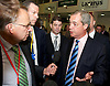 UKIP National Party Conference <br /> Day 2<br /> at Doncaster Race Course, Doncaster, Great Britain <br /> 27th September 2014 <br /> <br /> Nigel Farage <br /> walking through the exhibition area at the Conference <br /> taling to Michael Crick <br /> <br /> Photograph by Elliott Franks <br /> Image licensed to Elliott Franks Photography Services