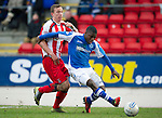 St Johnstone v Kilmarnock.....09.03.13      SPL.Nigel Hasselbaink holds off Jeroen Tesselaar.Picture by Graeme Hart..Copyright Perthshire Picture Agency.Tel: 01738 623350  Mobile: 07990 594431