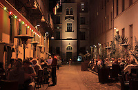 People eating outside in restaurants at night in Oranienburgerstrasse, Berlin, Germany. Picture by Manuel Cohen