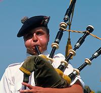 Man playing Bagpipe at Highland Games isn Fergus, Ontairo, Canada. Man playing Bagpipe. Fuergus Ontario Canada Highland Games.
