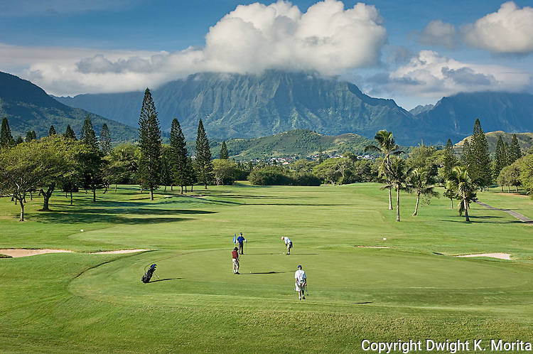 The Koolau range looms in the background as golfers complete the ninth hole at Mid-Pacific Country Club.