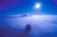 Stock photo of tops of downtown Houston Skyscrapers rising through the fog in the morning