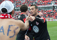 06 October 2012: D.C. United forward Hamdi Salihi #9 celebrates the only goal with a fan during an MLS game between DC United and Toronto FC at BMO Field in Toronto, Ontario Canada. .D.C. United won 1-0..