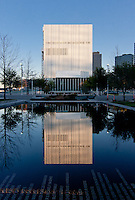 The Wyly Theatre, part of AT&T Performing Arts Center, in Dallas reflected in the reflecting pool near the Winspear Opera House.