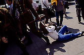 "Santiago, Chile.September 15, 1988..Chilean police arrest a woman by dragging her by her backpack straps when she shouted anti-General Augusto Pinochet slogans in support of the ""no"" vote for the plebiscite during a rally. ..In 1988, General Augusto Pinochet ordered a plebiscite vote asking Chilean citizens whether he should continue in office. It produced a decisive ""no"" vote and the following year he lost the first presidential election in 19 years. However, under a constitution crafted by his advisors, he remained as army commander until 1998. Pinochet continued to wield enormous power until his arrest in London on human rights charges in October 1998."