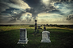 Country scene in USA with dramatic sky over churchyard