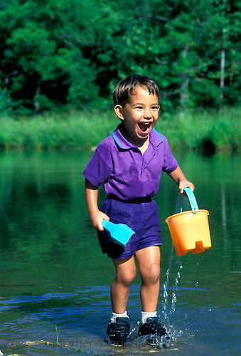 Grandmas lake: Young Afghan American boy thrilled at the cool water toys